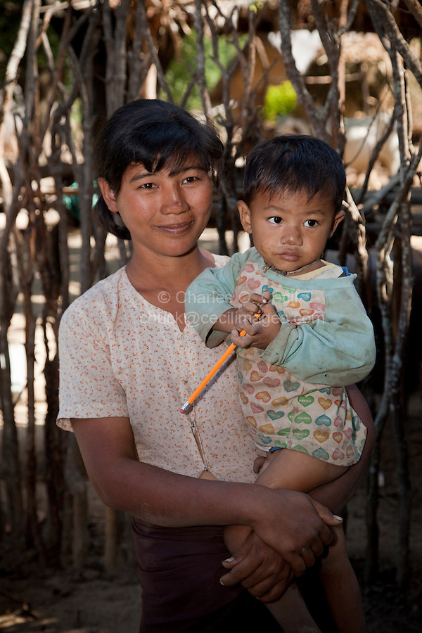 Myanmar, Burma.  Mother and Child, Village near Bagan.  Burman (Bamar) ethnic group.