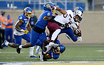 BROOKINGS, SD - MAY 2: Justin Strong #5 of the Southern Illinois Salukis is brought down by a trio of defenders from the South Dakota State Jackrabbits at Dana J Dykhouse Stadium on May 2, 2021 in Brookings, South Dakota. (Photo by Dave Eggen/Inertia)