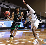 SIOUX FALLS, SD - MARCH 7: Caleb Nero #0 of the North Dakota Fighting Hawks drives to the basket against DeShang Weaver #14 of the Oral Roberts Golden Eagles during the Summit League Basketball Tournament at the Sanford Pentagon in Sioux Falls, SD. (Photo by Richard Carlson/Inertia)