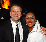 Tillman Fertitta with Linda Lorelle at the Houston Rockets Tux & Tennies benefit at Toyota Center Thursday March  27,2008. (Dave Rossman/For the Chronicle)