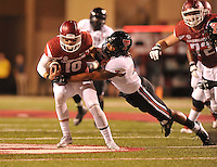 NWA Democrat-Gazette/MICHAEL WOODS • @NWAMICHAELW<br /> University of Arkansas Quarterback Brandon Allen is tackled by Texas Tech defender Dakota Allen as he runs the ball in the 3rd quarter of Saturday nights game against the Razorbacks at Razorback Stadium in Fayetteville.
