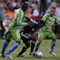 DC United forward Luciano Emilio (11) fights for possession of the ball against Seattle Sunders FC. defender Jhon Kennedy Hurtado (34)  The Seattle Sounders FC defeated DC United 2-1at RFK Stadium, Saturday September 12 , 2009.