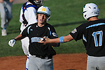 14 August 10: Ocala's Kirby McMullen gets a high-five after scoring during the second inning of a 15-1 win in the Cal Ripken Babe Ruth World Series 12U Majors in Aberdeen, Maryland