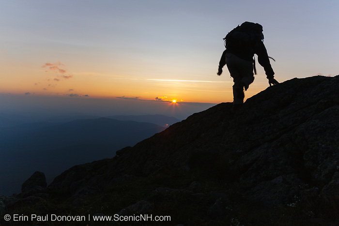 A hiker travels along the Gulfside Trail (Appalachian Trail), near the summit of Mount Clay, in Thompson and Meserve's Purchase, in the New Hampshire White Mountains at sunset. Mount Clay is named for Henry Clay, a 19th-century senator.