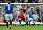 Rangers v St Johnstone....28.08.10  .Kenny Miller prods the ball past Graeme Smith to put Rangers 2-1 up.Picture by Graeme Hart..Copyright Perthshire Picture Agency.Tel: 01738 623350  Mobile: 07990 594431