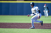 Michigan Wolverines outfielder Tito Flores (22) leads off second base during the NCAA baseball game against the Illinois Fighting Illini on March 20, 2021 at Fisher Stadium in Ann Arbor, Michigan. Michigan won the game 8-1. (Andrew Woolley/Four Seam Images)