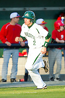 Brad Elwood (2) of the Charlotte 49ers hustles down the third base line to score a run against the Delaware State Hornets at Robert and Mariam Hayes Stadium on February 15, 2013 in Charlotte, North Carolina.  The 49ers defeated the Hornets 13-7.  (Brian Westerholt/Four Seam Images)