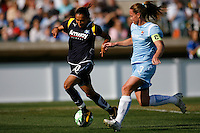 Marta Vieira da Silva (10) of the Los Angeles Sol is chased by Christie Rampone (3) of Sky Blue FC during a Women's Professional Soccer match at TD Bank Ballpark in Bridgewater, NJ, on April 5, 2009. Photo by Howard C. Smith/isiphotos.com