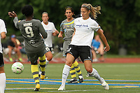 magicjack defender, Marian Dalmy (2), clears the ball away from onrushing Philadlephia forward, Danesha Adams (9).  With five different players scoring, the Philadephia Independence overpowered magicjack, 6-0 on June 18th at Widener University in Chester, PA.
