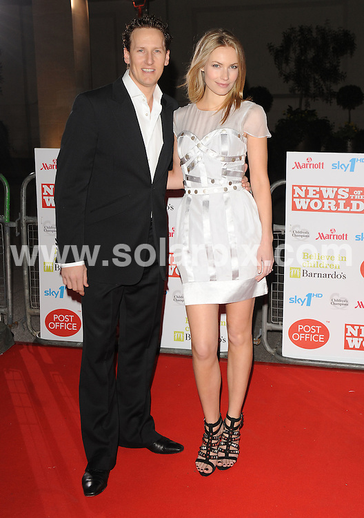 **ALL ROUND PICTURES FROM SOLARPIX.COM**.**WORLDWIDE SYNDICATION RIGHTS**.Red carpet arrivals at Children's Champions..Held at The Grosvenor House Hotel, Mayfair, London, on Wednesday March 03, 2010...This pic: Brendan Cole and fiance Zoe Hobbs..JOB REF:10839 SSD     DATE: 03_03_2010.**MUST CREDIT SOLARPIX.COM OR DOUBLE FEE WILL BE CHARGED**.**MUST NOTIFY SOLARPIX OF ONLINE USAGE**.**CALL US ON: +34 952 811 768 or LOW RATE FROM UK 0844 617 7637**
