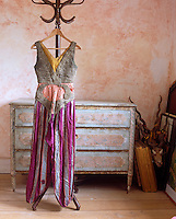 """A heavily embroidered striped costume designed for the Ballet """"Thamar"""" in 1912, its delicate silken fabric torn in some places"""