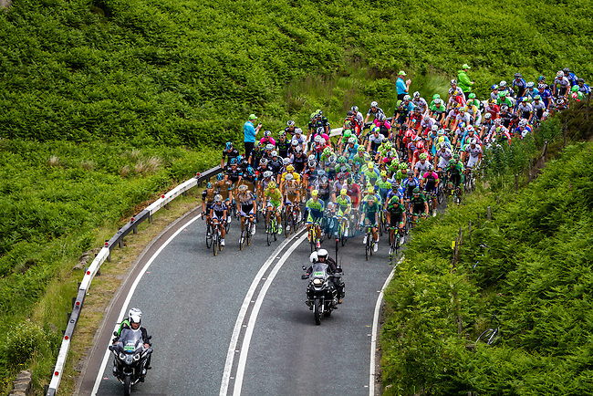 The peleton climb the first climb of the day at Cote de Blubberhouses during Stage 2 of the 2014 Tour de France running 200km from York to Sheffield. 6th July 2014.<br /> Picture:Thomas van Bracht/Peloton Photos/www.newsfile.ie