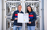 ORLANDO, FL - FEBRUARY 28: Ashlyn Harris #18 and Ali Krieger #11 of the United States stand with a city proclamation at City Hall on February 28, 2020 in Orlando, Florida.