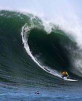 Half Moon Bay, California - January 24, 2014: 2014 Maverick's Invitational Greg Long with a nice drop in.