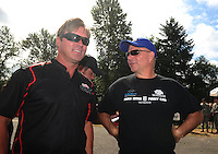 Aug. 7, 2011; Kent, WA, USA; NHRA funny car driver Mike Neff (left) with Tim Wilkerson during the Northwest Nationals at Pacific Raceways. Mandatory Credit: Mark J. Rebilas-