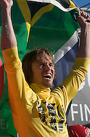"""Grant """"Twiggy"""" Baker holds up a South African flag on stage during the awards ceremony at the 2008 Mavericks Surf Contest in Half Moon Bay, Calif., Saturday, January 12, 2008...Photo by David Calvert/isiphotos.com"""