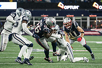 FOXBOROUGH, MA - NOVEMBER 24: New England Patriots Runningback Sony Michel #26 is tackled by Dallas Cowboys Cornerback Byron Jones #31 and Dallas Cowboys Safety Xavier Woods #25 during a game between Dallas Cowboys and New England Patriots at Gillettes on November 24, 2019 in Foxborough, Massachusetts.