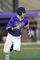 Shortstop Brett Huebner (3) of the Furman Paladins runs out a batted ball in game two of a doubleheader against the Harvard Crimson on Friday, March 16, 2018, at Latham Baseball Stadium on the Furman University campus in Greenville, South Carolina. Furman won, 7-6. (Tom Priddy/Four Seam Images)