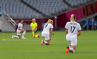 TOKYO, JAPAN - JULY 21: Lindsey Horan #9 of the USWNT kneels during a game between Sweden and USWNT at Tokyo Stadium on July 21, 2021 in Tokyo, Japan.