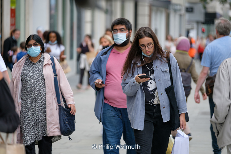 Midweek shoppers in Oxford Street London following the easing of Covid-19 lockdown restrictions.