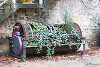 Mas de Perry, Mas Nicot. Terrasses de Larzac. Languedoc. Wine press. Old, used as flower pot and garden decoration. France. Europe.