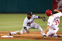 Jean Segura (8) of the Arkansas Travelers stretches to get the force out at second base during a game against the Springfield Cardinals at Hammons Field on June 13, 2012 in Springfield, Missouri. (David Welker/Four Seam Images)