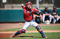 Kia Tigers catcher Bum-soo Shin (62) throws down to second base during an Instructional League game against the Colorado Rockies on October 5, 2016 at Salt River Fields at Talking Stick in Scottsdale, Arizona.  (Mike Janes/Four Seam Images)