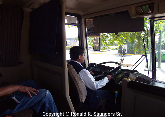 BUS DRIVER NAVIGATES the CITY STREETS of AMECAMECA