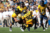 Mychal Kendricks and Mike Mohamed combine on the play. The California Golden Bears defeated the UCLA Bruins 35-7 at Memorial Stadium in Berkeley, California on October 9th, 2010.