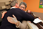 Dr. Joanne Kurtzberg, center, hugs William Massart, left, happy with the news that Massart's daughter Sandra Massart, 10, right, has accepted her father's stem cells, at Duke University Hospital in Durham, NC, USA, on Tuesday, Feb. 14, 2012.  Sandra Massart is being treated for MLD, a degenerative condition.  Photo by Ted Richardson