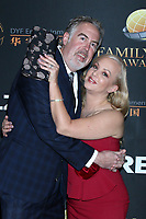 LOS ANGELES - MAR 24:  George Covey, Wendi McLendon-Covey at the 14th Family Film Awards at the Universal Hilton Hotel on March 24, 2021 in Universal City, CA