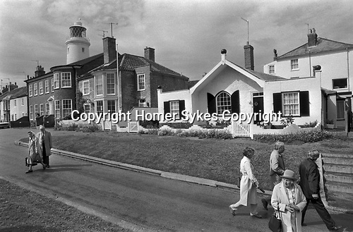 Seaside architecture Southwold Suffolk 1980s East Angelia UK. Older group people on a weekend summer break 1985 England