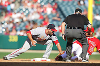 Washington Nationals second baseman Danny Espinosa #18 tags out Los Angeles Angels outfielder Bobby Abreu #53 at second base at Angel Stadium on June 29, 2011 in Anahein,California. (Larry Goren/Four Seam Images)