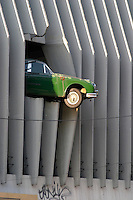 Parking garage with an old Jaguar falling out, original sculpture. Bordeaux city, Aquitaine, Gironde, France