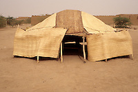 Agadez, Niger - Tuareg Shelter, Tent, Dust in Sky.  Dust in the sky often turns it a brown or grayish color in this area on the fringe of the Sahara.