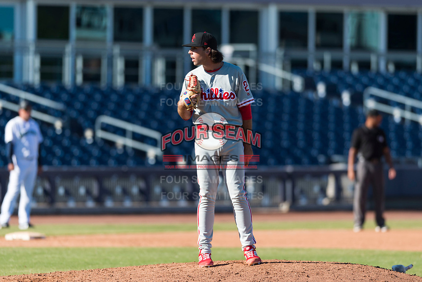 Scottsdale Scorpions relief pitcher Jonathan Hennigan (2), of the Philadelphia Phillies organization, looks in for the sign during an Arizona Fall League game against the Peoria Javelinas at Peoria Sports Complex on October 18, 2018 in Peoria, Arizona. Scottsdale defeated Peoria 8-0. (Zachary Lucy/Four Seam Images)