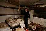Buncefield Oil Depot Blast Disater happened on December 11, 2005. Ian Silverstein (35) one of the victims of the disaster pictured here one year on at his totally destroyed home. Hemel Hempstead, UK. December 6, 2006..Copyright Photo: Helen Atkinson +44 7976 265253