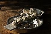 Culuene River, Mato Grosso State, Brazil. PIV Culuene; manioc (cassava) balls drying, ready to make beju pancakes.
