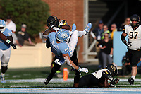 CHAPEL HILL, NC - SEPTEMBER 21: Beau Corrales #15 of the University of North Carolina is sent flying while being tackled by Steven Jones #12 and Akeem Davis-Gaither #24 of Appalachian State University during a game between Appalachian State University and University of North Carolina at Kenan Memorial Stadium on September 21, 2019 in Chapel Hill, North Carolina.