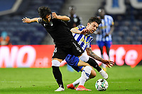 22nd April 2021; Dragao Stadium, Porto, Portugal; Portuguese Championship 2020/2021, FC Porto versus Vitoria de Guimaraes; Mateus Uribe of FC Porto dispossess Rochinha of Vitoria de Guimaraes