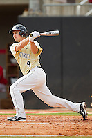 Matt Martin #4 of the Wake Forest Demon Deacons follows through on his swing against the North Carolina State Wolfpack at Doak Field at Dail Park on March 17, 2012 in Raleigh, North Carolina.  The Wolfpack defeated the Demon Deacons 6-2.  (Brian Westerholt/Four Seam Images)