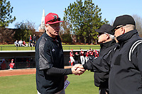 GREENSBORO, NC - FEBRUARY 22: Head coach Bill Currier of Fairfield University shakes hands with the umpires during a game between Fairfield and UNC Greensboro at UNCG Baseball Stadium on February 22, 2020 in Greensboro, North Carolina.