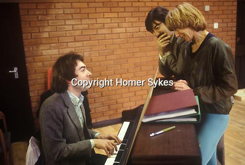 Andrew Lloyd Webber,  Trevor Nunn, Gillian Lynne London England circa 1980. Working on the new musical Cats.