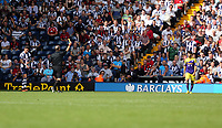 Sunday 01 September 2013<br /> Pictured: Match referee Mike Dean (2nd R) shows Alejandro Pozuelo (R) of Swansea a yellow card.<br /> Re: Barclay's Premier League, West Bromwich Albion v Swansea City FC at The Hawthorns, Birmingham, UK.