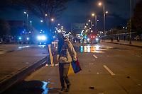 BOGOTA - COLOMBIA, 25-05-2021: Un manifestante de primera línea cubierto con una bándera de Colombia camina durante los disturbios en el sector de las Américas de la ciudad de Bogotá durante el día 28 del Paro Nacional en Colombia hoy, 25 de mayo de 2021, para protestar contra el gobierno de Ivan Duque además de la precaria situación social y económica que vive Colombia. El paro fue convocado por sindicatos, organizaciones sociales, estudiantes y la oposición. / A front-line protester covered with a Colombian flag walks during the riots at Portal Las Americas sector of the city of Bogota during the day 28 of the National strike in Colombia today, May 25, 2021, to protest against the government of Ivan Duque in addition to the precarious social and economic situation that Colombia is experiencing. The strike was called by unions, social organizations, students and the opposition in Colombia. Photo: VizzorImage / Diego Cuevas / Cont