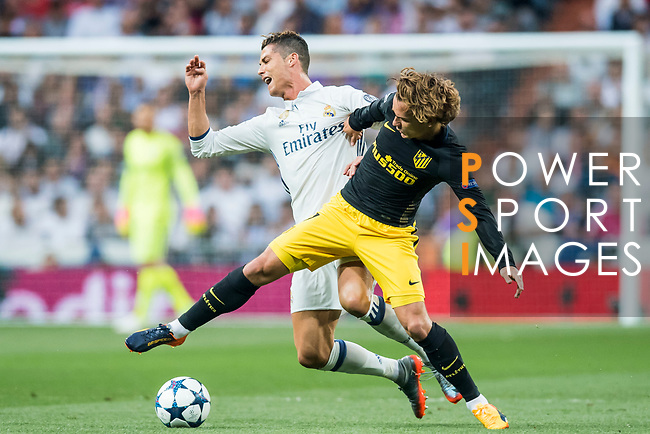 Cristiano Ronaldo (l) of Real Madrid fights for the ball with Antoine Griezmann of Atletico de Madrid during their 2016-17 UEFA Champions League Semifinals 1st leg match between Real Madrid and Atletico de Madrid at the Estadio Santiago Bernabeu on 02 May 2017 in Madrid, Spain. Photo by Diego Gonzalez Souto / Power Sport Images