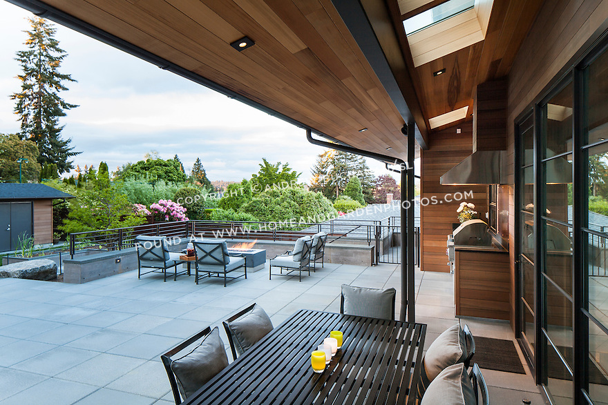 Patio area with outdoor dining table and firepit with comfortable seating area.