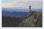 Photoshop. Man balancing atop the Rocky Mountains, Colorado.