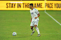 WASHINGTON, DC - SEPTEMBER 27: Brandon Bye #15 of New England Revolution moves the ball during a game between New England Revolution and D.C. United at Audi Field on September 27, 2020 in Washington, DC.