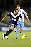 MELBOURNE, AUSTRALIA - FEBRUARY 18, 2010: Carlos Hernandez from Melbourne Victory looking to pass the ball the ball in the first leg of the A-League Major Semi Final match between the Melbourne Victory and Sydney FC at Etihad Stadium on February 18, 2010 in Melbourne, Australia. Photo Sydney Low www.syd-low.com